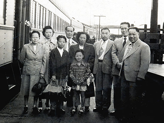 Harry Quan (3rd from right) greets his wife (center) and relations, Ken Quan-Lee (boy) and Lily Quan (girl) arriving at Ottawa's Union Station, 1949. Others: Jack Sim (2nd from right) and his wife, Rosina (2nd from left). Harry owned a café where the Rideau Center now stands. (Courtesy of Tom Doon, Robert Hum and Lily Hum)