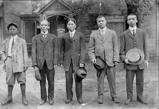 n front of Hope Yue Laundry, Slater St., Ottawa, circa. 1913. Shung Joe, patriarch of one of Ottawa's pioneer families, is on far right. His half-brother is 2nd from right.