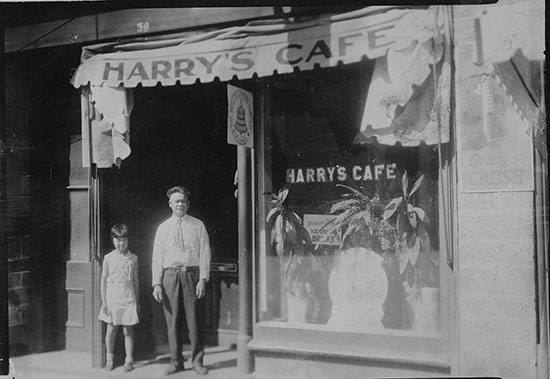 Harry Fong Johnston and his daughter Doris, in front of his café, Perth, On., circa. late 1920s. (Courtesy of Linda Hum)